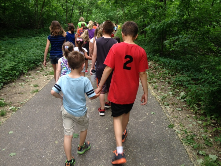 Kindergarten and 4th grade buddies walk to Hagar Park