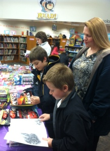 Everyone enjoys the variety of books offered during the book fair.