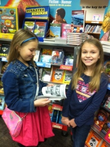 Ellie and Ayiana love reading and shopping at our book fair!