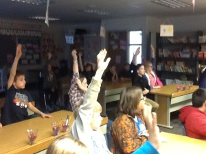 Students raise their hands to participate in the discussion!
