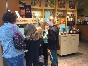 One group stops to sample the tea at Teavana.