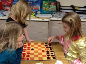 2nd graders playing checkers!