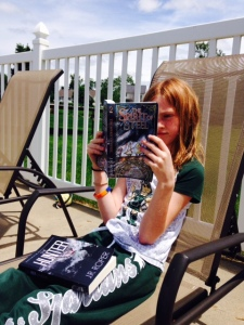 reading JR Roper's newest book The Spirit of Steel by the pool.