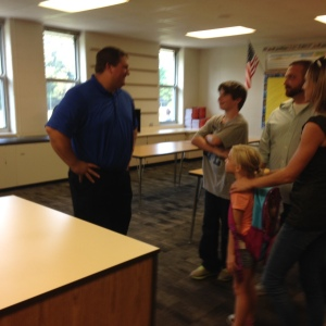 Mr. Steward greeting students