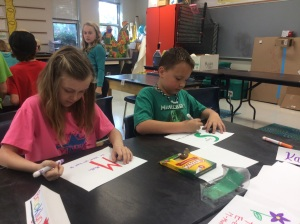 Creating a paper slide show on what STEM means