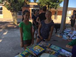 Pinewood sixth grade students helping organize the book exchange